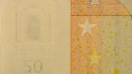 50 eurų vandens ženklas ženklas ant stalo